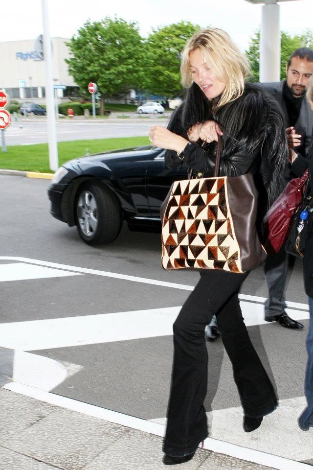 f4fdad1275cf Kate Moss is wearing a FENDI fur cape and the new FENDI