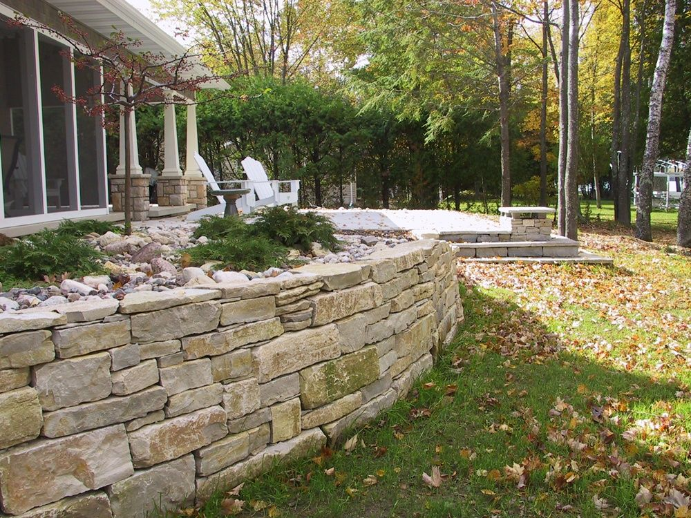 Limestone Outcroppings Retaining Hill And Adding Beauty With Flowers Trees And Shrubs Easy Landscaping Front Yard Outdoor Landscape Design Landscaping Shrubs