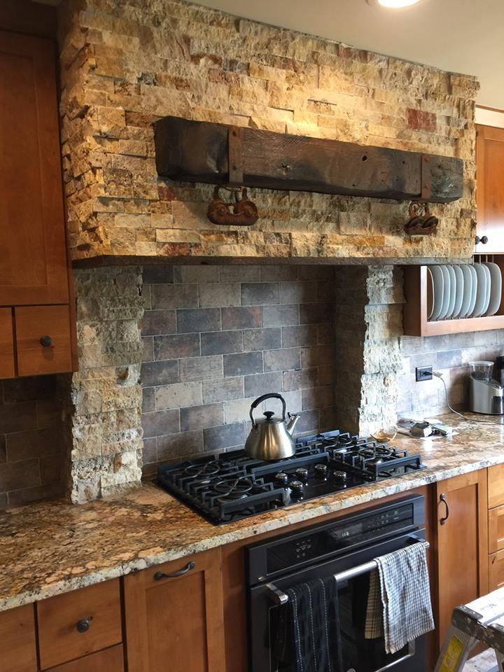 This is such an amazing stacked stone hood vent with reclaimed barn wood beam! The rustic embellishments were salvaged by the homeowner from found hardware for a true barn door! I am so happy to have wonderful clients that allowed me to work side by side with them to create a truly unique kitchen that expresses their personality!  http://whiteoakinteriors.com/  #whiteoakinteriors #kitchen #kitchendesign #homestyling Chicago, Illinois #hoodvent #vent