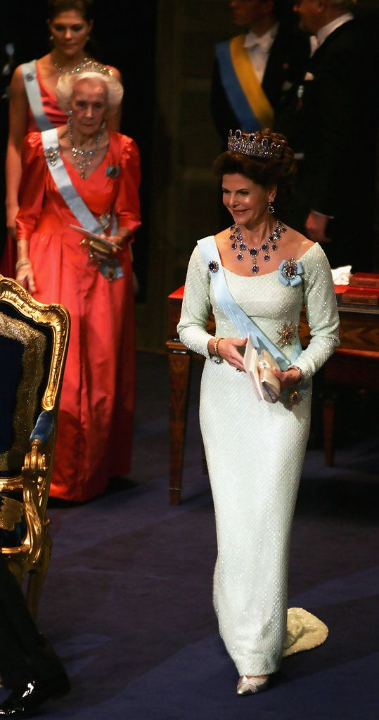 Queen Silvia of Sweden arrives at the award ceremony for the Nobel Prizes at City Hall December 10, 2004 in Stockholm, Sweden. Behind is Princess Lilian and Crown Princess Victoria