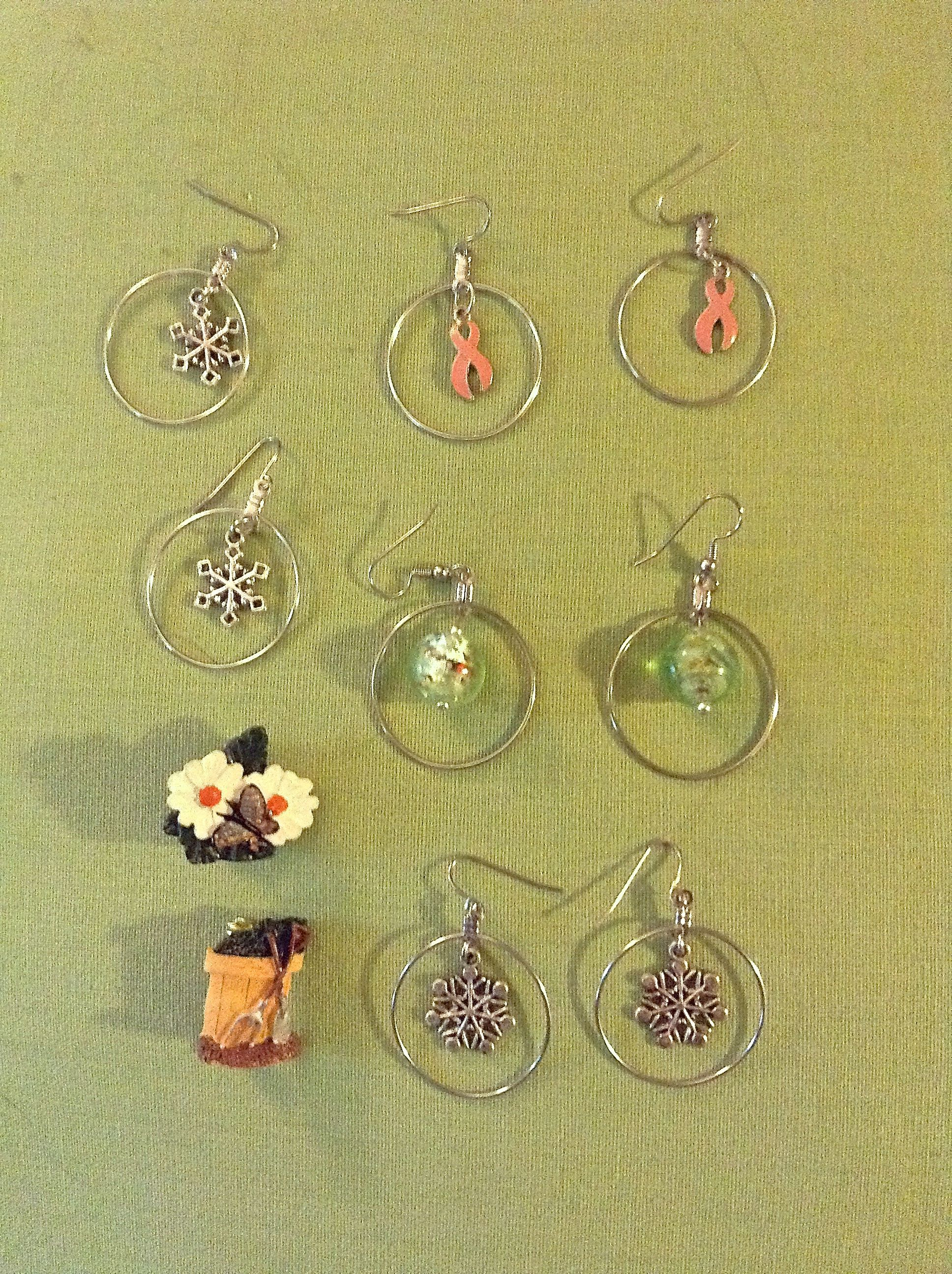Breast Cancer Awareness earrings and assorted other earrings. (Pins I didn't create, just added pins to the back.