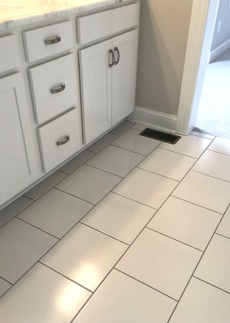 White 12 X 12 Floor Tile With Black Grout In Offset Installation Pattern Bathroom Flooring Floor Tile Grout Tile Floor