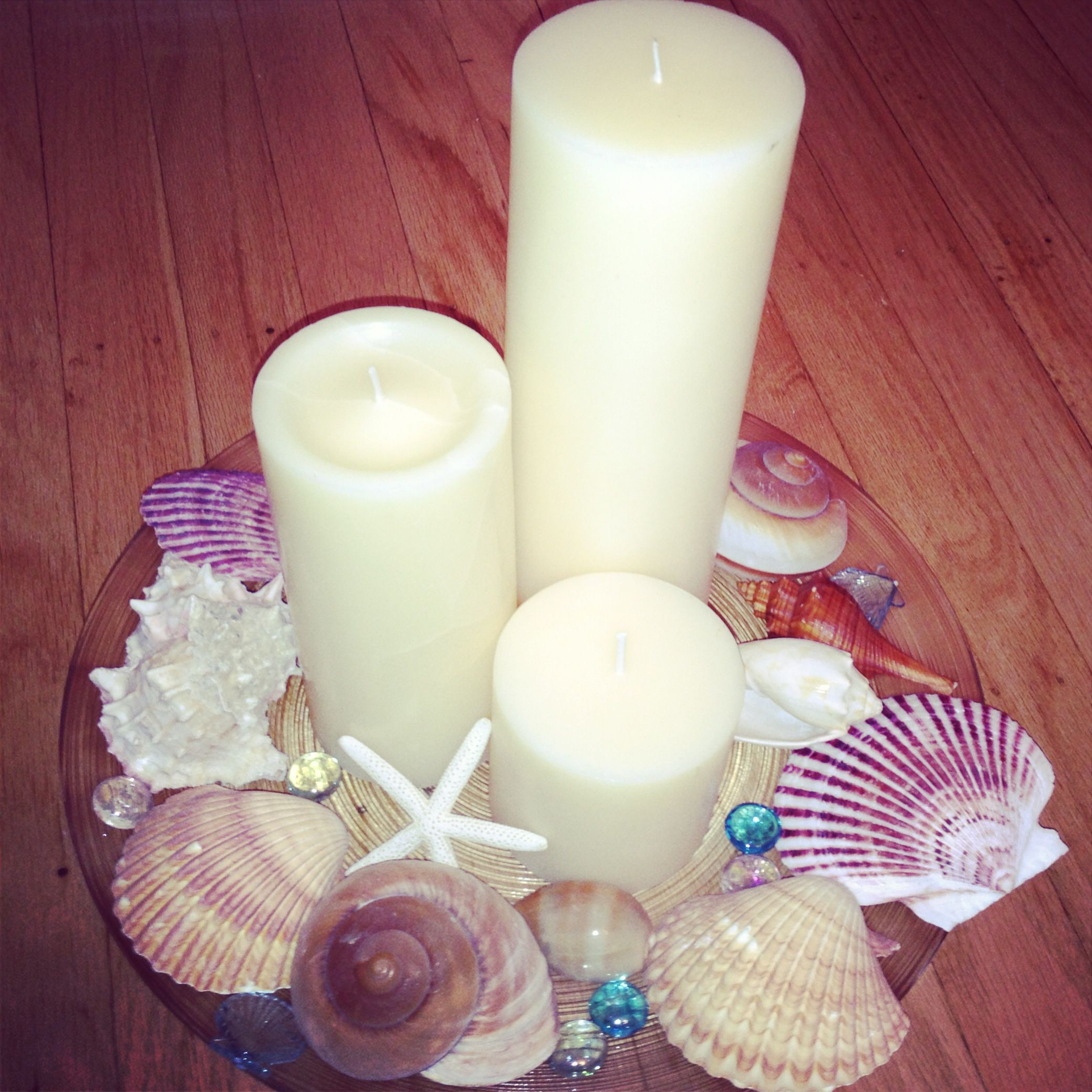 Beach wedding centerpieces - candles and seashells