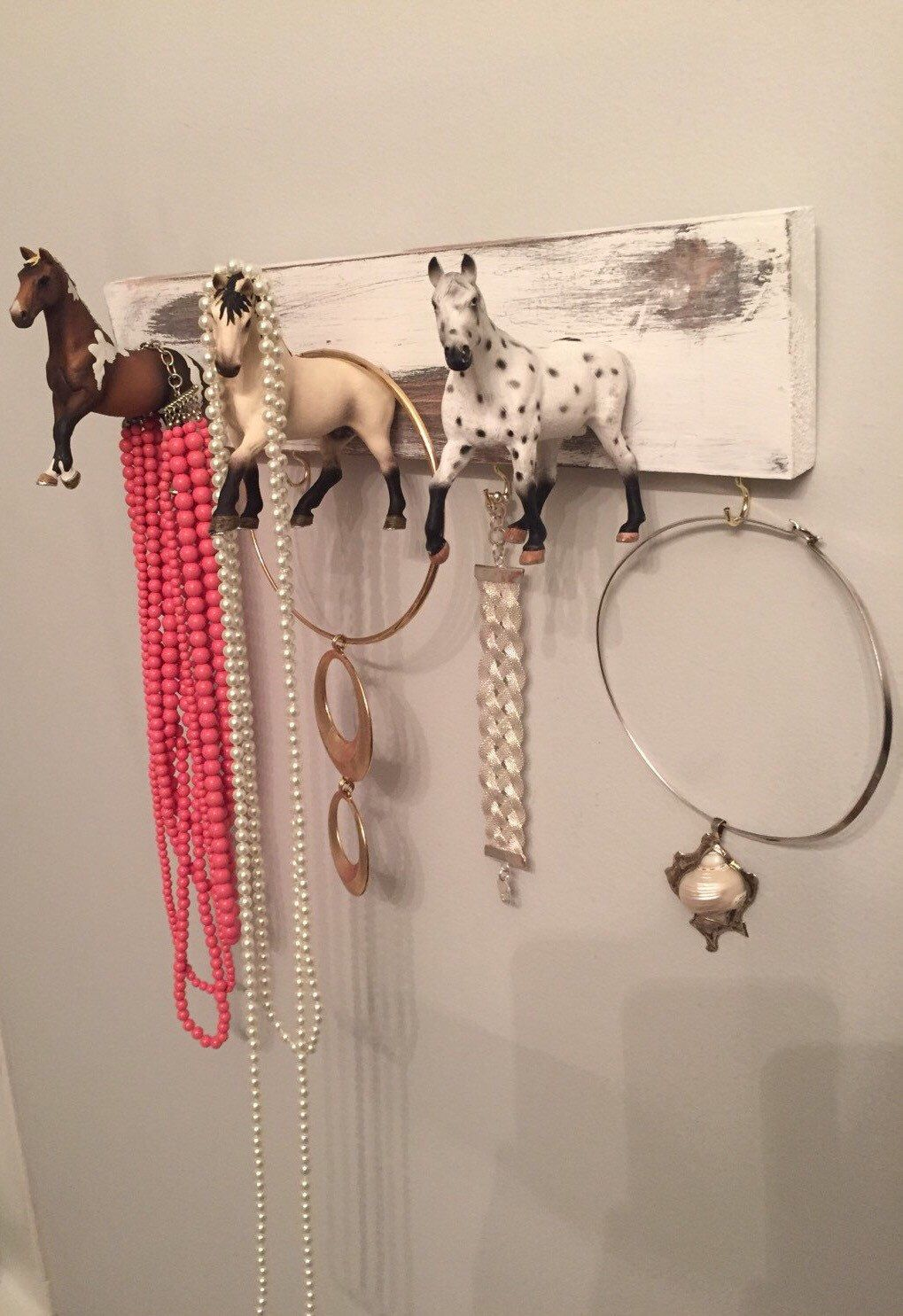 A personal favorite from my Etsy shop https://www.etsy.com/listing/247523831/horse-jewelry-display-and-key-rack-scarf