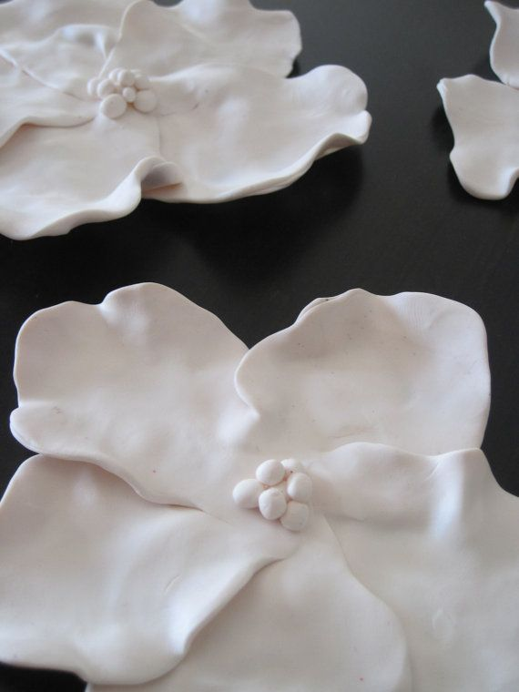 clay wall flowers - may work for icing and choc pearls