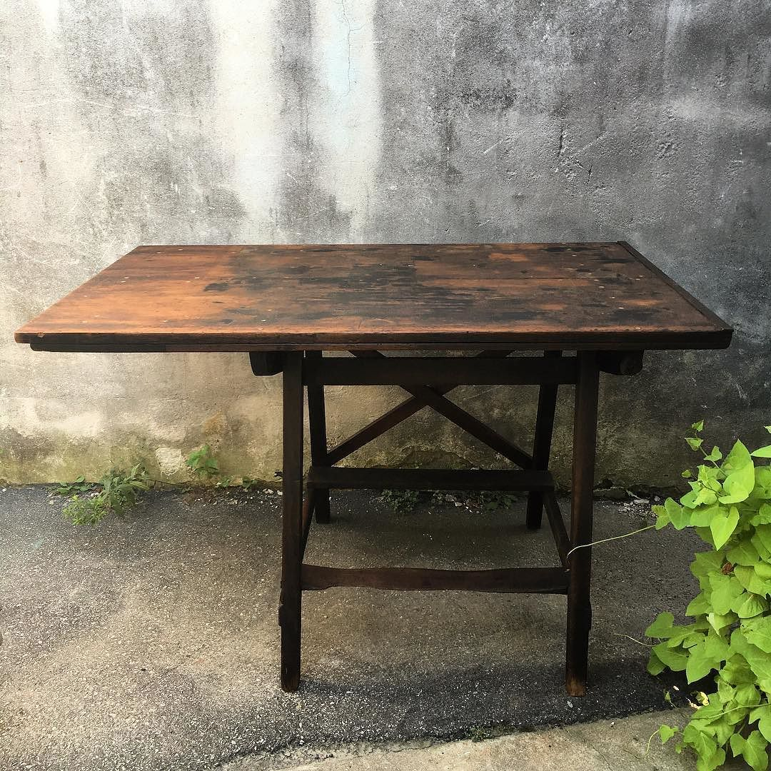 I see the most amazing kitchen island backdropped by a brick wall with industrial wood/metal stools... how about you?! This vintage drafting table had the kind of time worn patina that can't be faked! Look at how the bottom board is worn from years of rested feet! I'm in love with one...  Can't wait to see where she ends up! We are open 10-6 today  #timewornbeauty #patina #age #vintage #draftingtable #kitchenisland #table #luckyfind #unusualhome #industrialstyle #workingfurnitureshop…