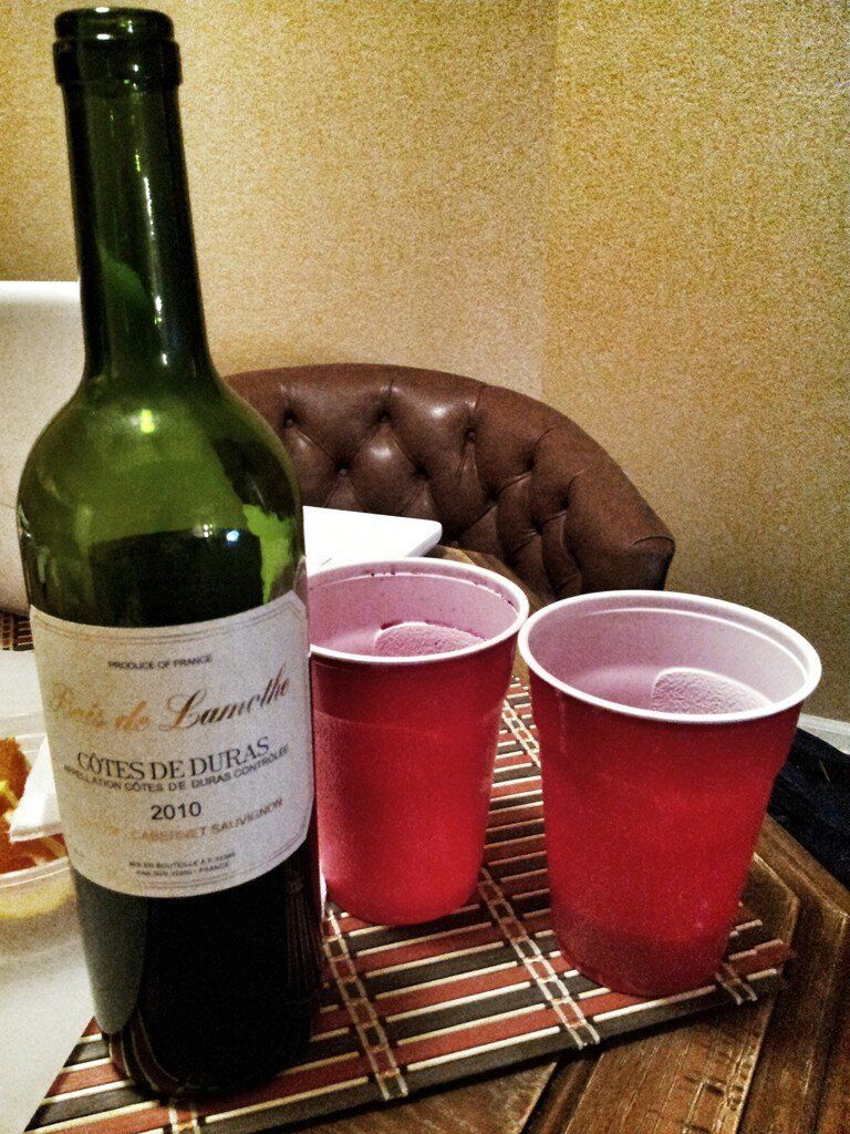 A Bottle Of Wine And Two Dixie Cups 3 Wine Bottle Wine Rack Wine