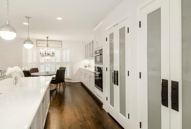Long white kitchen features Hudson Valley Lighting Lambert 1 Light ...