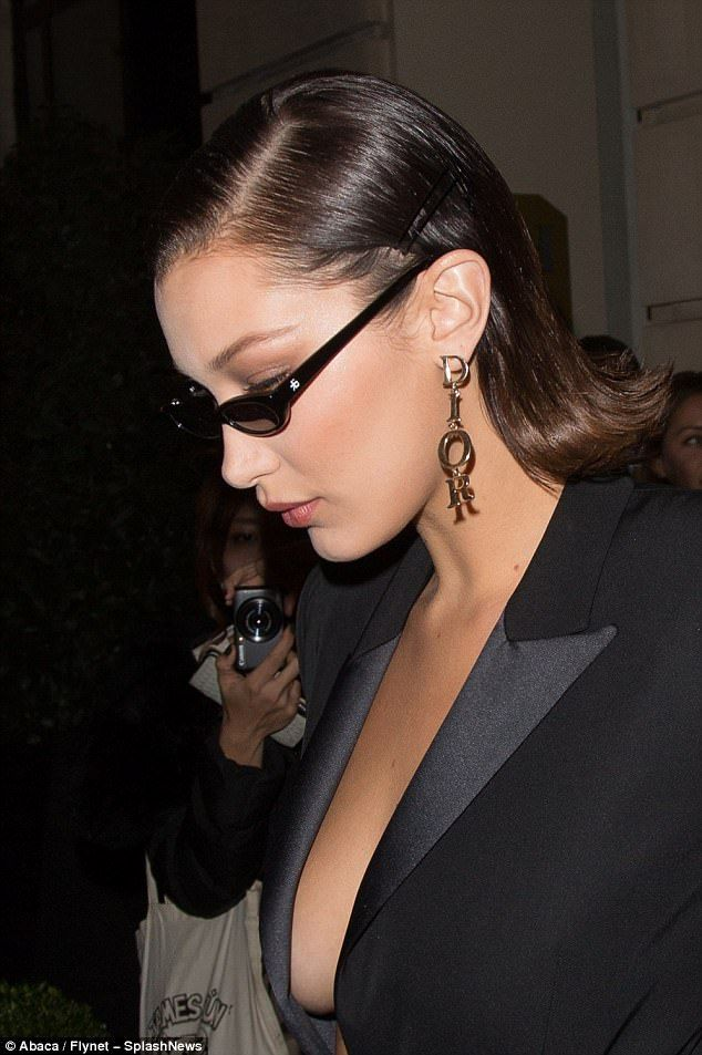 Bella Hadid flashes her abs in bold crop top as she heads out in Paris – bella