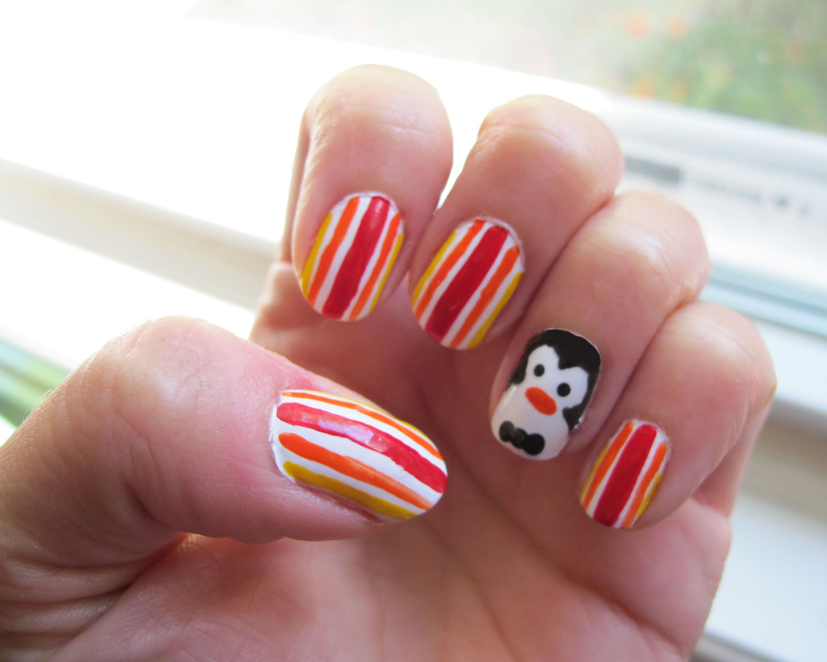 Jolly Holiday Manicure complete with penguin. Mary Poppins nails ...