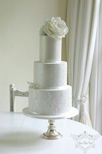 White Wedding Cake with shimmer and white roses