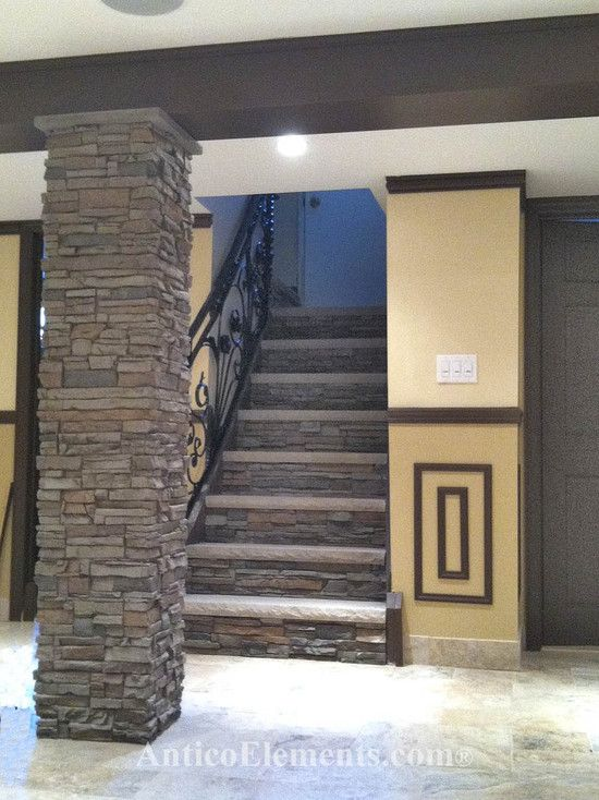 Just a few imitation stone panels can completely change the look of a basement.