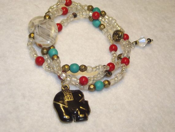 This wrap showcases glass seed beads, ceramic and turquoise accent beads. Adorned with an alloy elephant charm.
