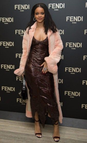 Rihanna stole the spotlight at the Fendi party, not only in her sequinned gown but by designing a Baguette bag herself