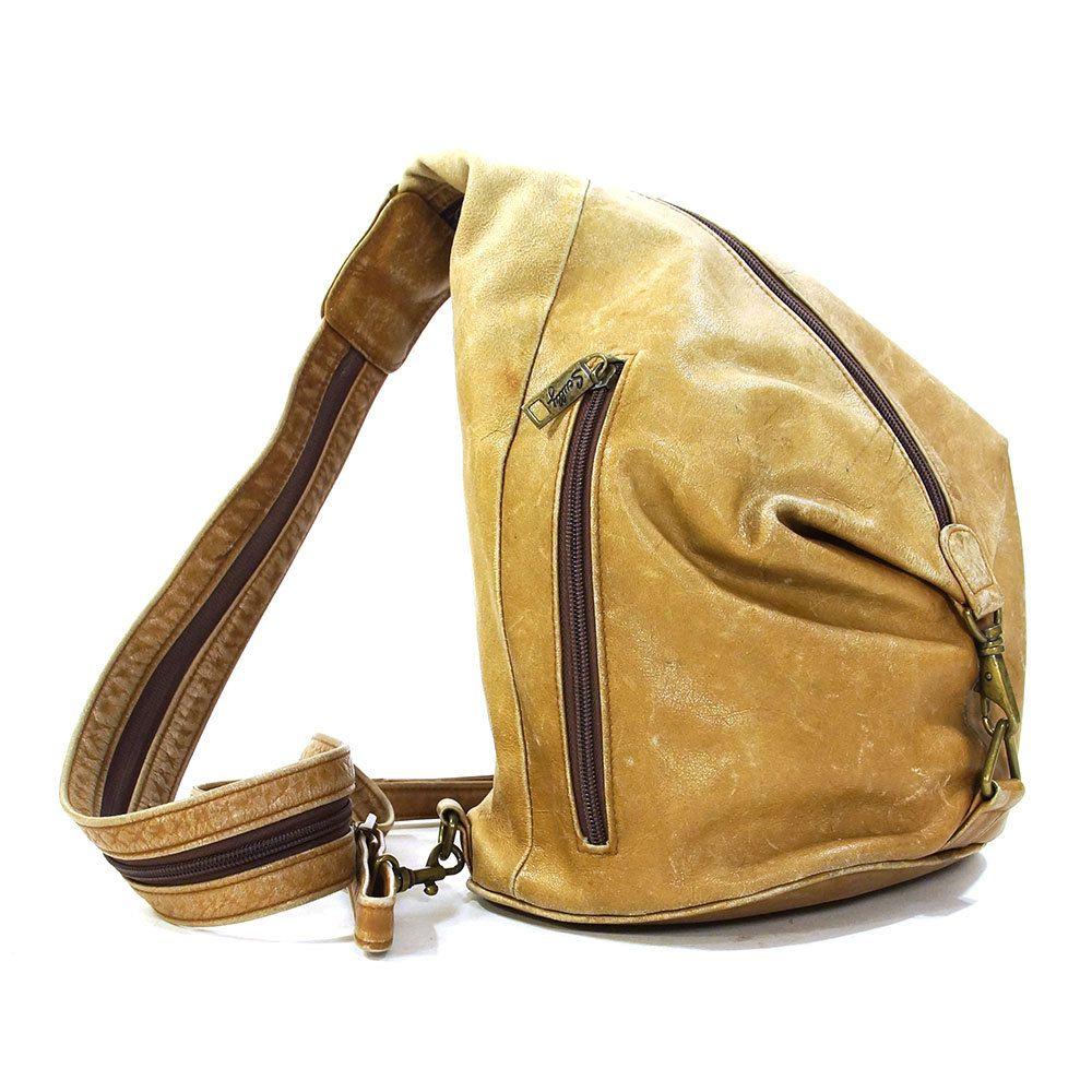 09b3837f2602 90s Leather Backpack   Vintage 1990s Convertible Sling Bag   Distressed  Brown Leather Purse with Adjustable Shoulder Straps   Zipper Pockets by  SpunkVintage