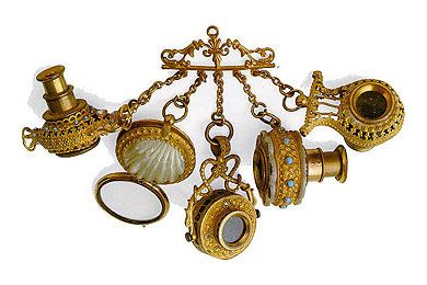 """I *love* chatelaines (though technically, this cannot be called a """"chatelaine"""" as it was created before the word came to use to describe items like this) """"Set of 5 small telescopes mounted on a pendant brass chatelaine. The pendants are of different shape. This type of telescope pendant Lunettes Breloques was in vogue in the early nineteenth century, was brought to the vest along with a few pairs of glasses (fassamani). It was the prevailing fashion for les incroyables that roamed the…"""