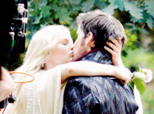 Guys... GUYS! Is This A CaptainSwan Marriage??!! She's Wearing White, Holding Flowers And Kissing Killian!!! My Shipper Heart Can't Even Handle This! Be Still My Shipper Heart #SomeoneSedateMe