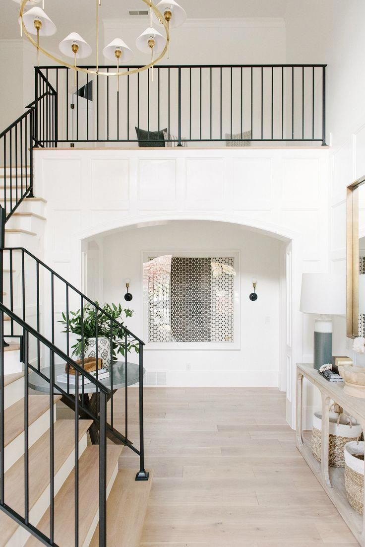 Our Favorite Hallmark Floors -  This modern staircase with the light wood floors creates a beautiful entryway.  - #BoatBuilding #DecoratingMobileHomes #favorite #floors #hallmark #KitchenRemodeling #MobileHomeKitchens #MobileHomeLiving #ModernStaircase #SplitLevelRemodel #TraditionalKitchens #banisterremodel