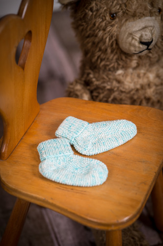 Photo of Knitting pattern on pearl knitted socks for babies in wool
