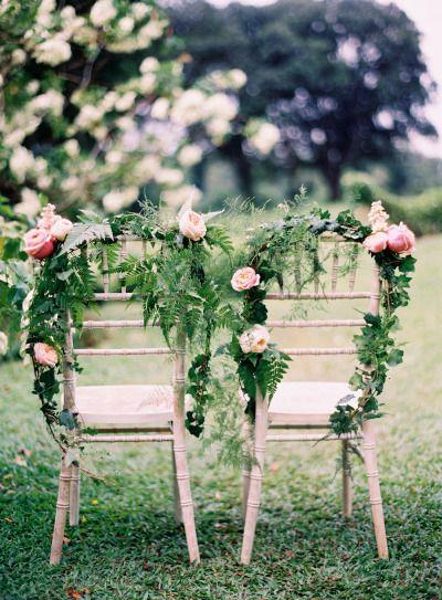 garland sweetheart chairs: http://www.stylemepretty/2015/01/26