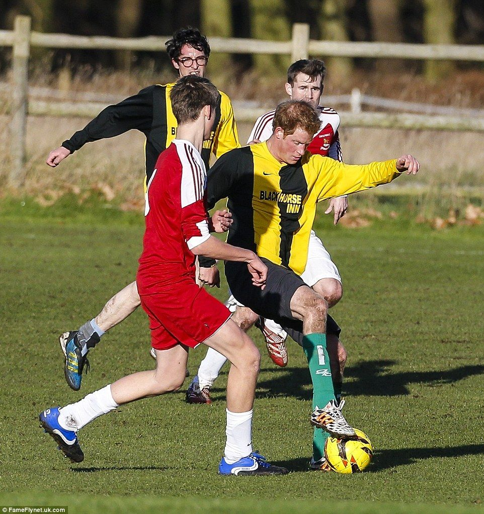 Harry Jostles For The Ball, Fending Off A Tackle