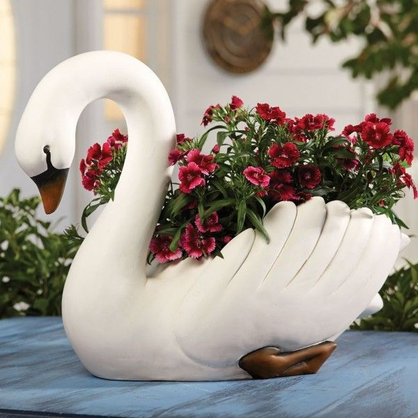 An elegant swan shaped planter is perfect for adding a bit of class to any porch