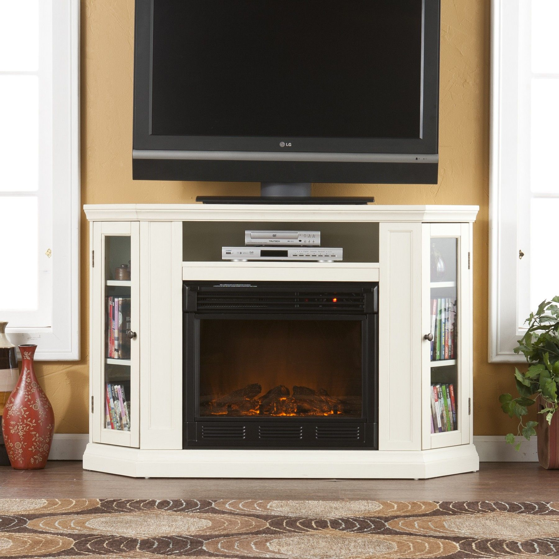 Pretty White Wooden Fireplace Mantle With Storage Under Large LCD Between White Windows Glass Frames Also Gray Geometric Rugs In Home Media Room Ideas