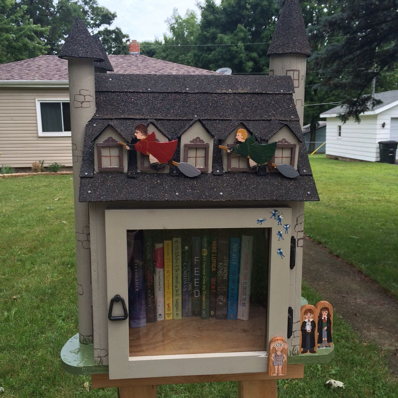 I have an incredibly talented mother! She made me a Hogwarts Free Little Library!! She watched the movie over and over so she could surprise me with it. All the little touches (like the Cornish...