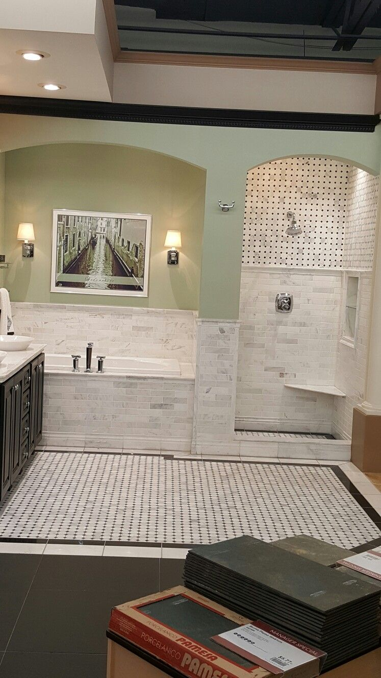 The wall between shower n tub to make cloth shower  curtain possible