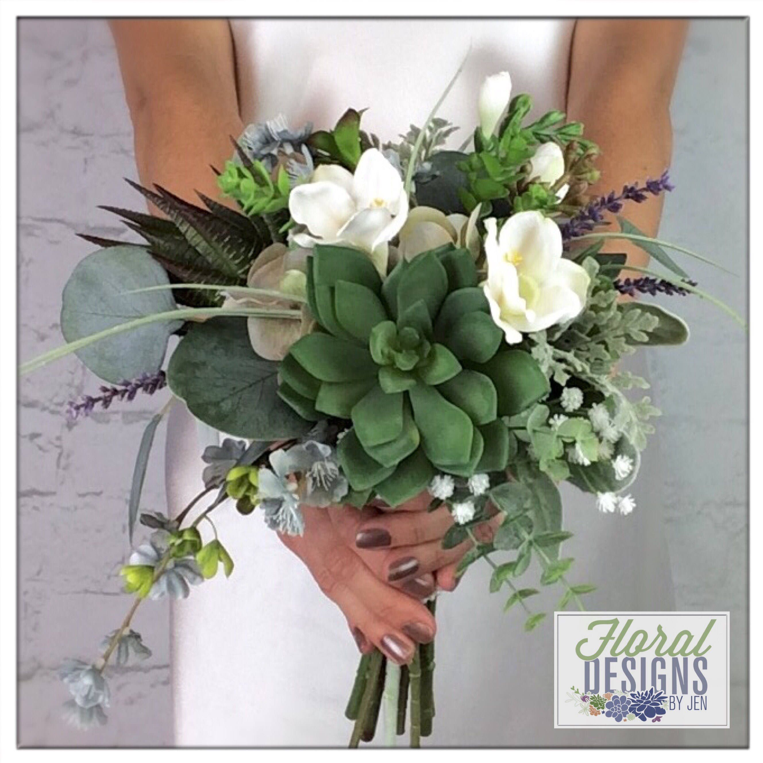 Love the succulents, eucalyptus, and baby's breath! Can't