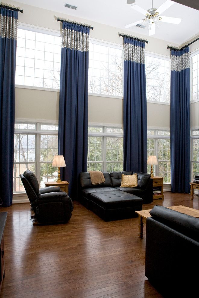 Two story window treatments living room traditional with for Living room window treatments