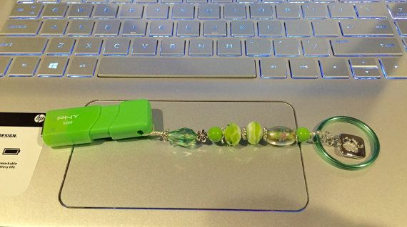 Pretty green flash drive keeper for St Patrick's Day or just for luck! 32gb flash drive included. Lucky shamrock charm, pretty lampwork bead, and gorgeous large green crystal make this key chain in a class all by itself! Gift this to someone you love, or indulge in a lucky flash fob!!!