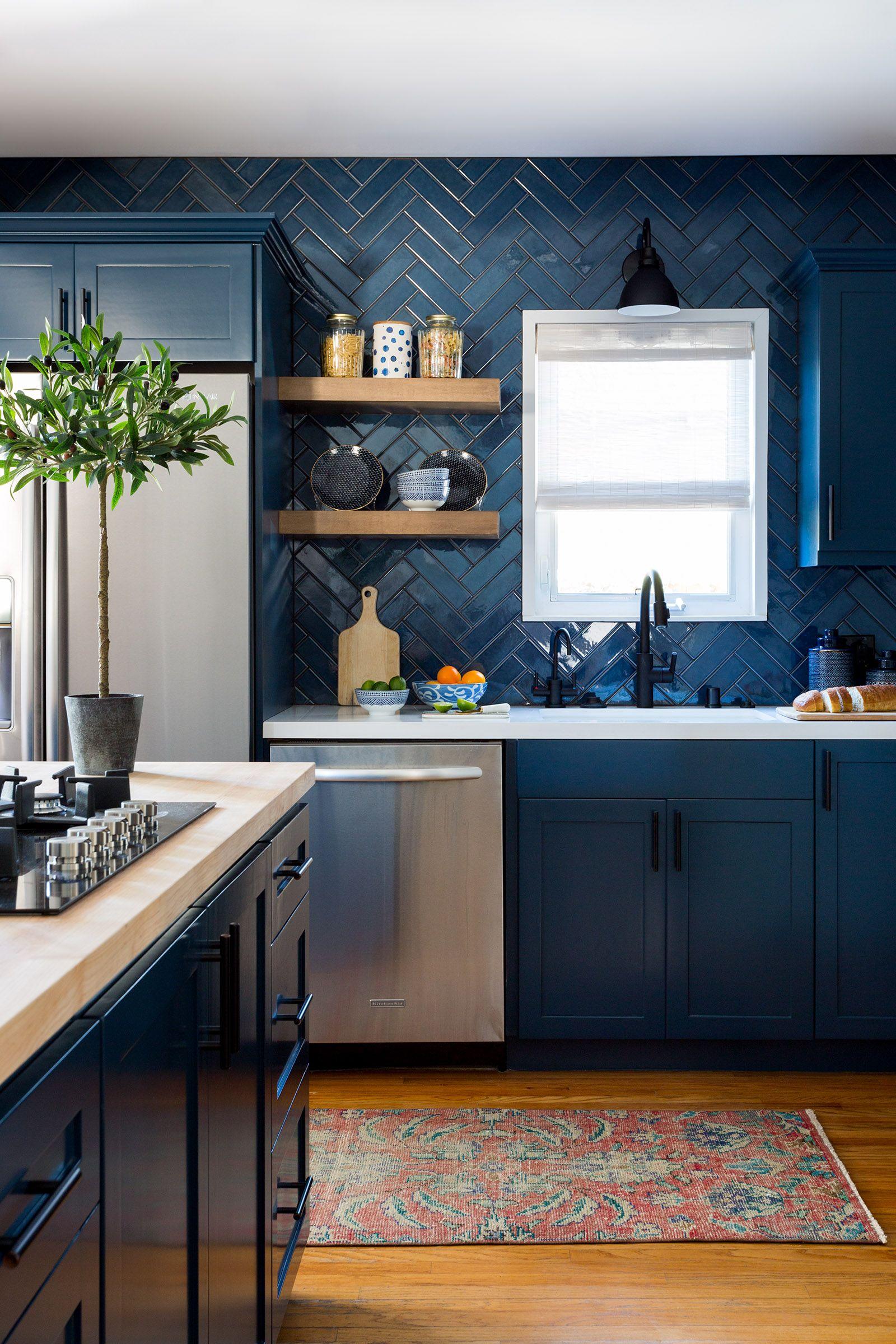 Dark blue kitchen with blue tile backsplash
