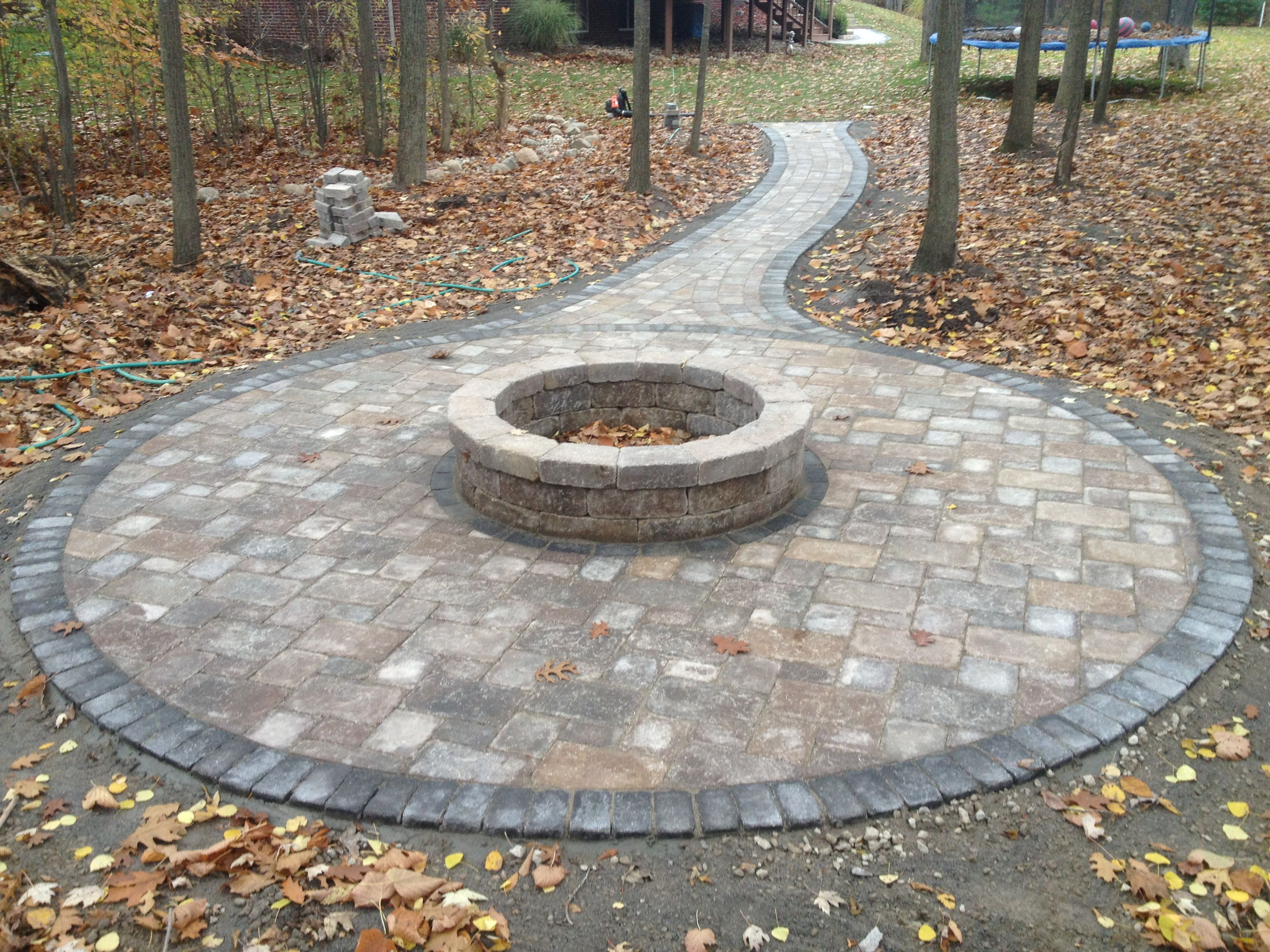 Fire pit in the woods brick paver patio and tumbled for Backyard brick fire pit