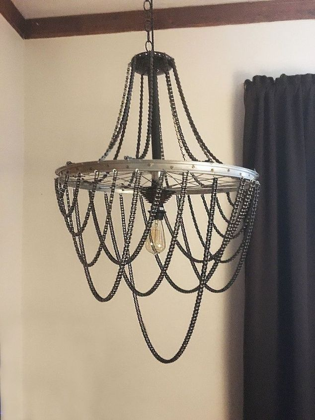 Turn a bicycle wheel into a chic industrial chandelier bicycle diy bicycle wheel and chain chandelier crafts how to lighting repurposing upcycling aloadofball Choice Image