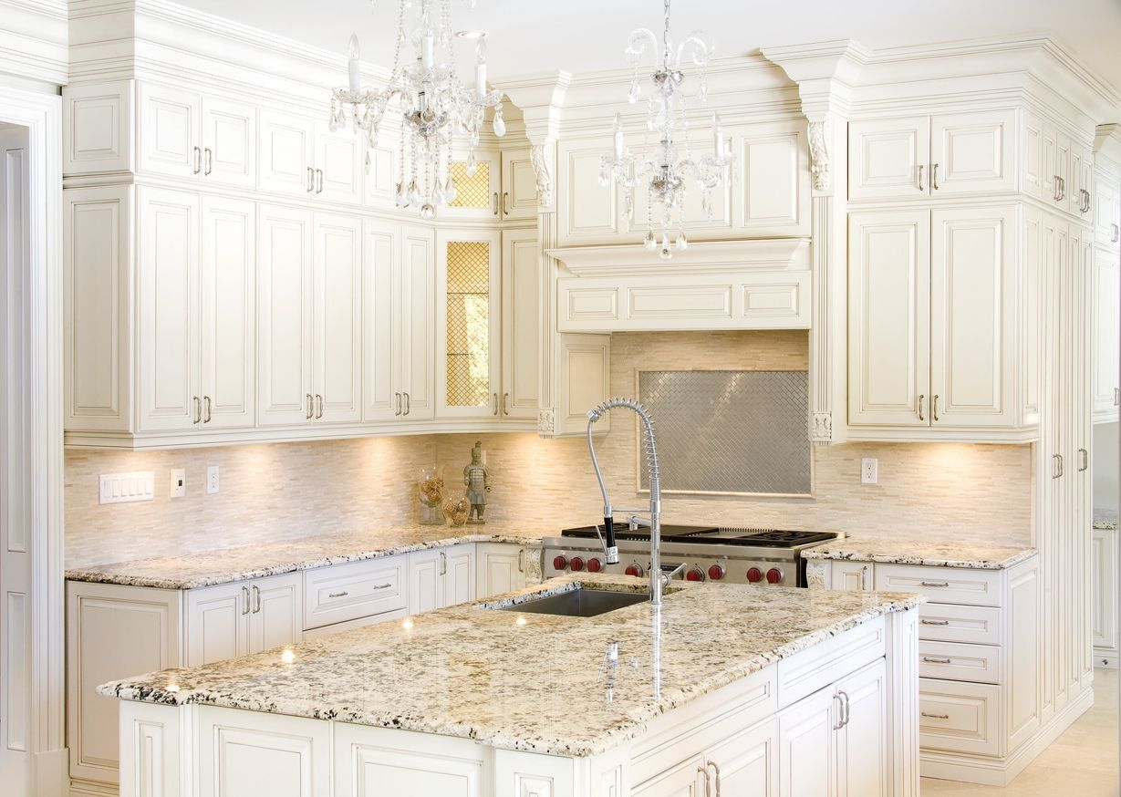 Elegant White Kitchen Cabinets Island Beige Granite Counter Beautiful Backsplash Lighting Kitc Antique White Kitchen Beige Kitchen Kitchen Cabinets And Granite