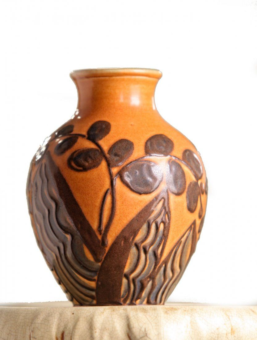 ROOKWOOD VASE.  Ohio, 1929. Semi matte glaze vase in orange and brown with foliate decoration. Artist signed for Elizabeth Barrett.