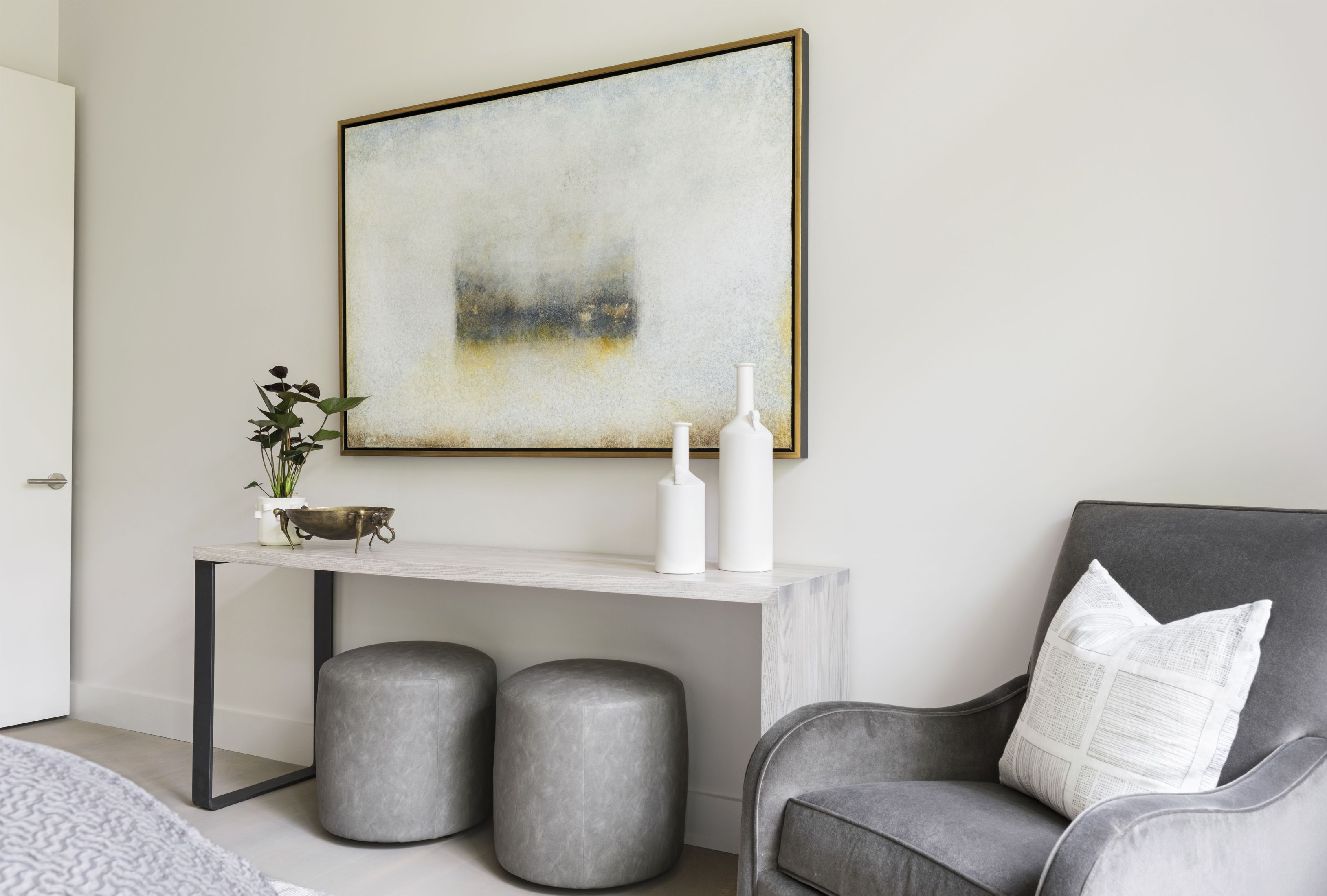 Modern, White Bedroom Interior Design Inspiration. Simple Decor In A Light  And Airy Farmhouse Bedroom. White Throw Pillow On A Gray Armchair.