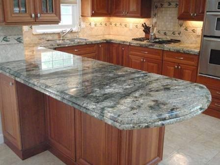 Polished Granite Countertops are still the top choice of most homeowners, traditional granite countertops offer a high-end look that adds to your kitchen's value while providing a durable prep surface. Because granite is a natural material, variation in the stone's pattern is common and, for most people, adds to its appeal. http://absolutegranite.guru/ #kitchenremodel #quartz #Cabinetry