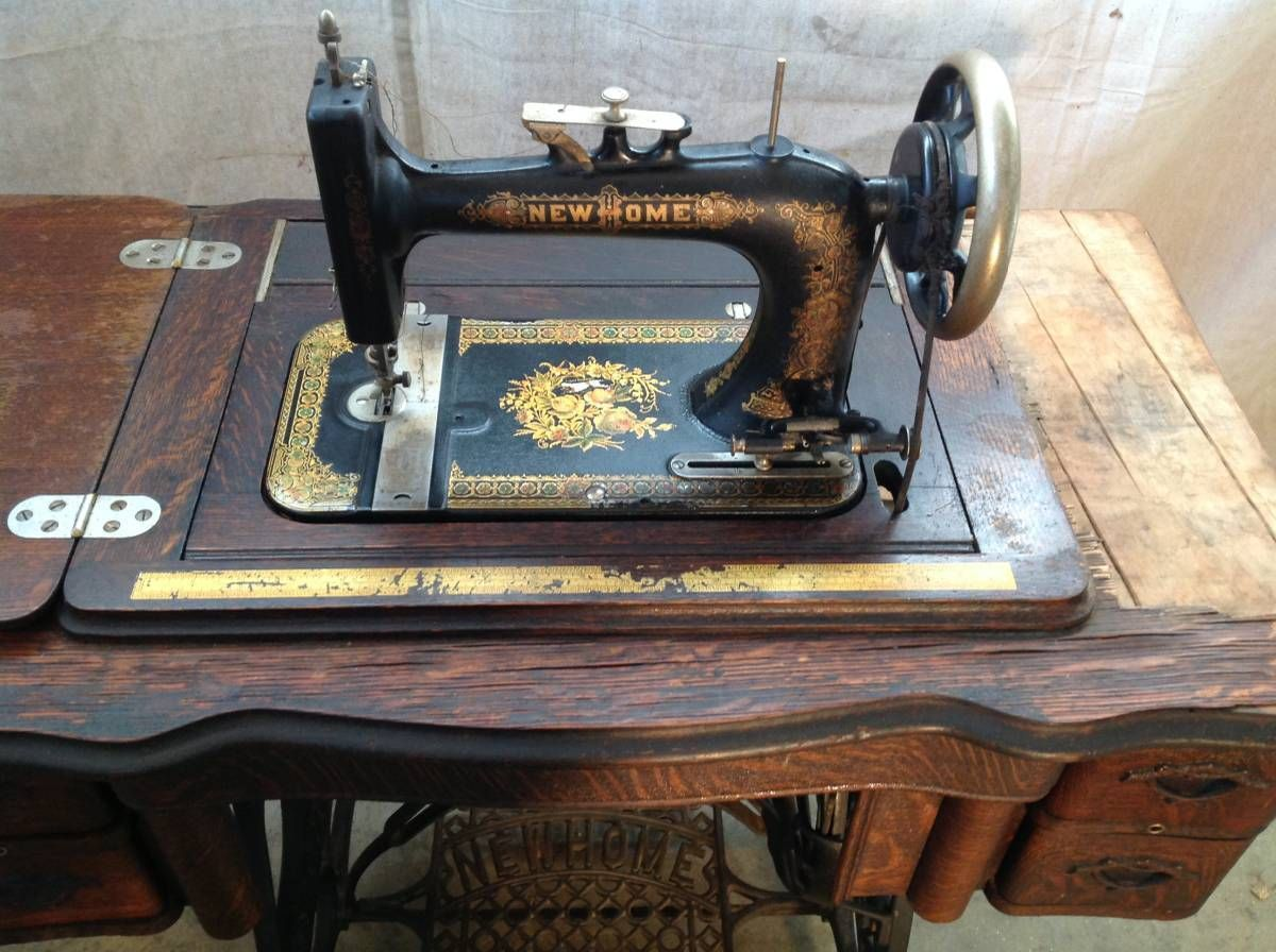 Antique 1915 New Home Treadle Sewing Machine with Original Accessories