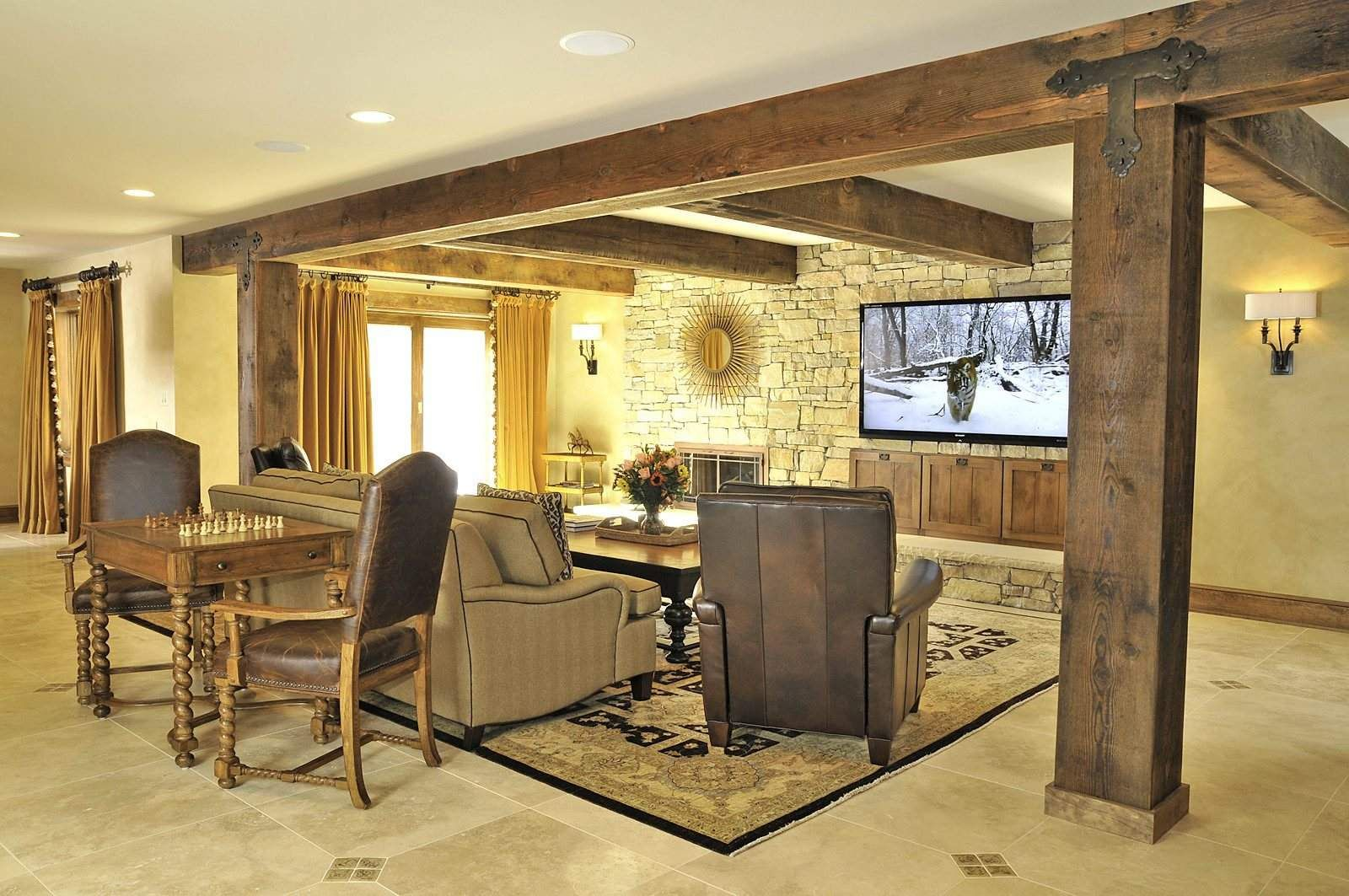 the transformed tv area features columns wrapped with reclaimed
