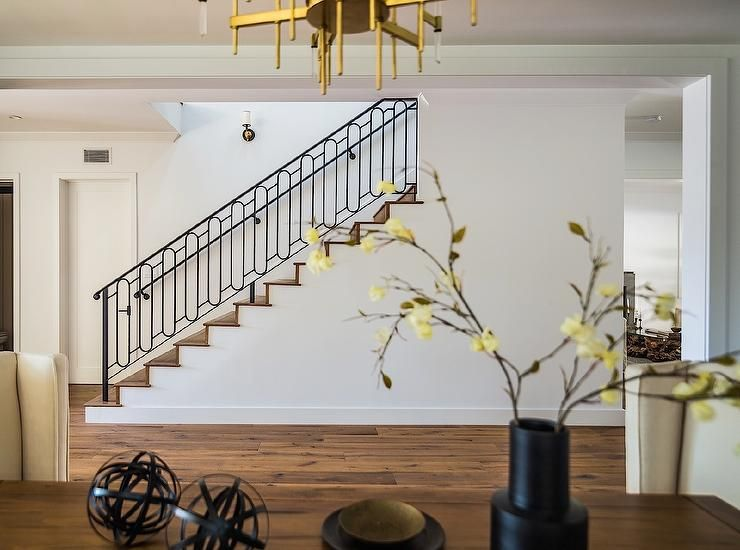 Foyer Opens To A Staircase Boasting An Iron Handrail And Iron Oval Staircase  Spindles Alongside Medium