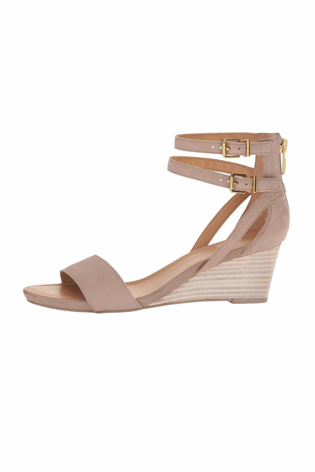 a5f315683a05 Seduce your style with the chic Danissa wedge sandal. Features ...