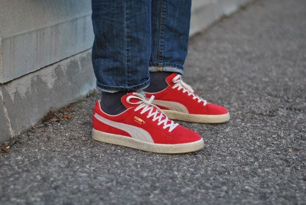 all red puma suede on feet