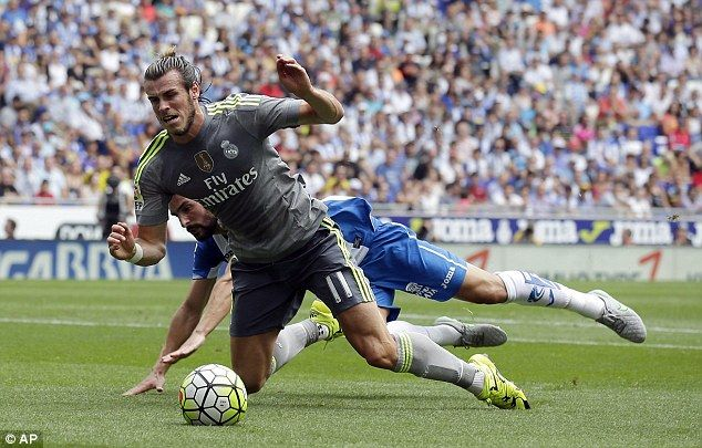 Gareth Bale takes a tumble under pressure from Espanyol's Alvaro Gonzalez during the first...