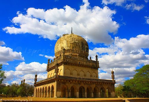 Sheened by those puffy white clouds ..  Qutub Shahi Tombs, Hyderabad, India.