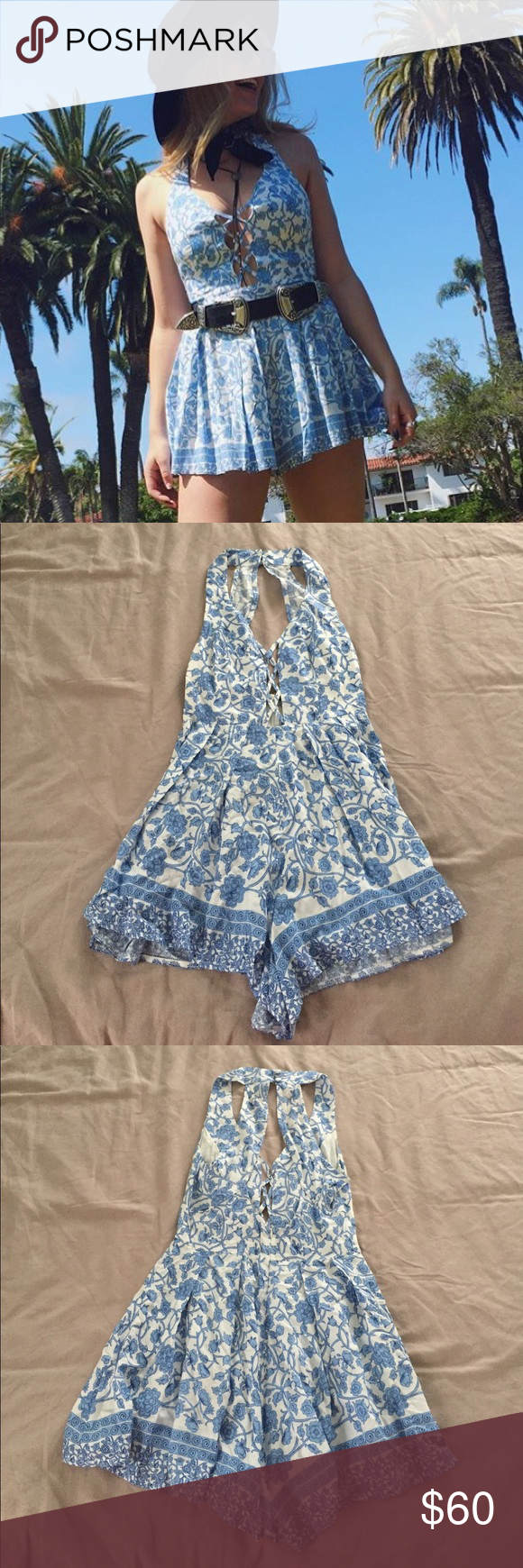 d5104a782b4e Rumor Boutique Floral Romper Blue and white floral printed romper form LF.  Only worn once! Invisible back zip closure. Neckline detail. LF Pants  Jumpsuits   ...