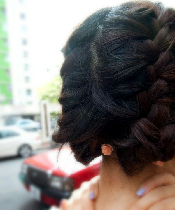 french braids with flower hairpins