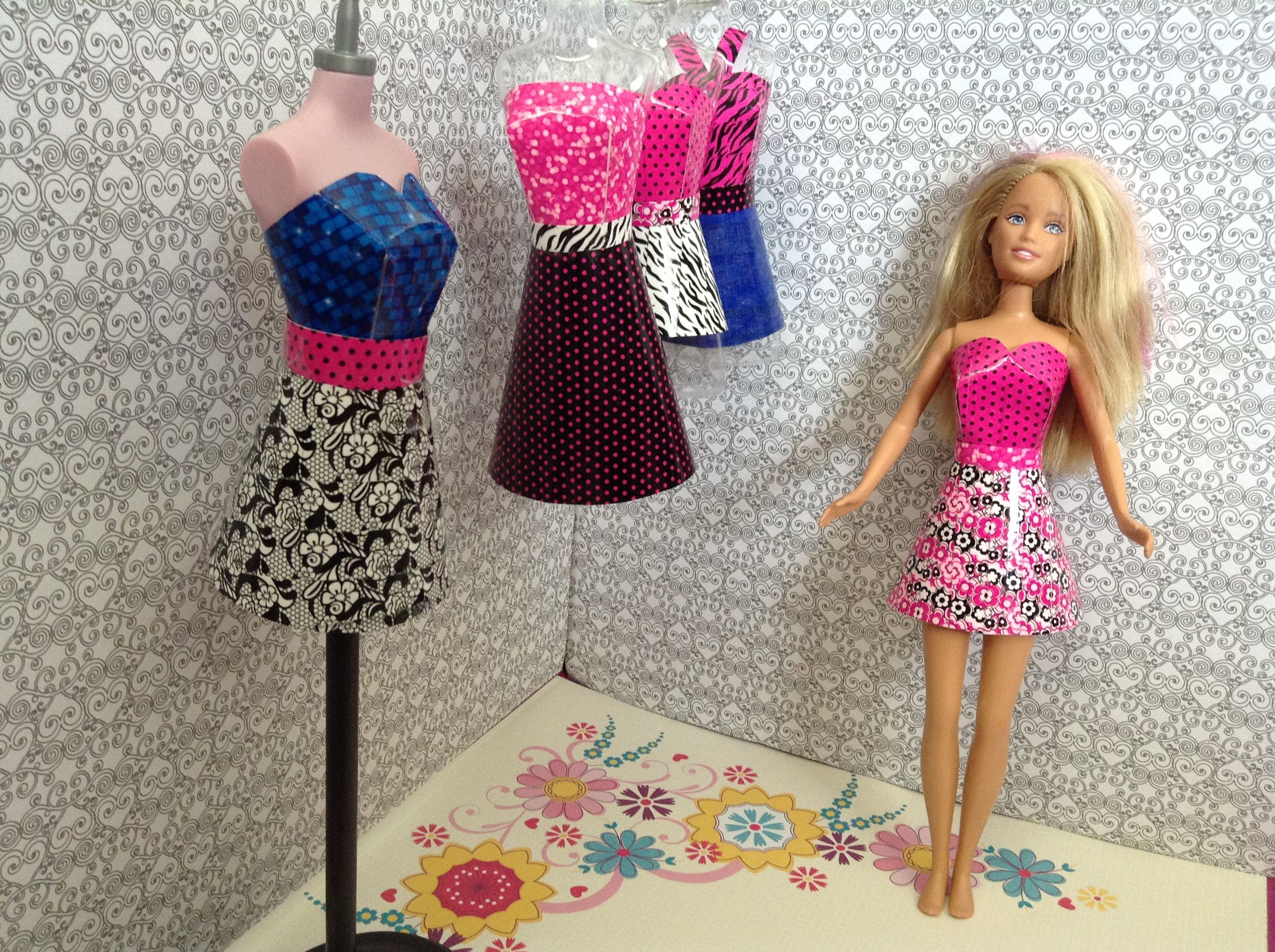 Homemade Barbie Dresses!!!  How to make Barbie dresses 1.Print or make a dress template. 2.Decorate any way your want.You can use cute tape,glitter,stickers,colored pencils,etc. 3.Cut the dress out using the template. 4.Use clear tape to tape the dress on a doll,manican,or a hanger. 5.Have fun playing with your new dress.