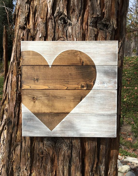 This cute rustic heart sign measures 14 x 14. This is a made to order item so the exact sign pictured is not available, but one similar will be made. There may be some variation in each item since no two wooden boards are the same.  This sign is stained in dark walnut and lightly painted in parchment to give it a rustic look. It is coated with a clear polyurethane protectant. I attach a hook on the back for easy hanging.  My current turnaround is approximately 1-2 weeks plus shipping time…